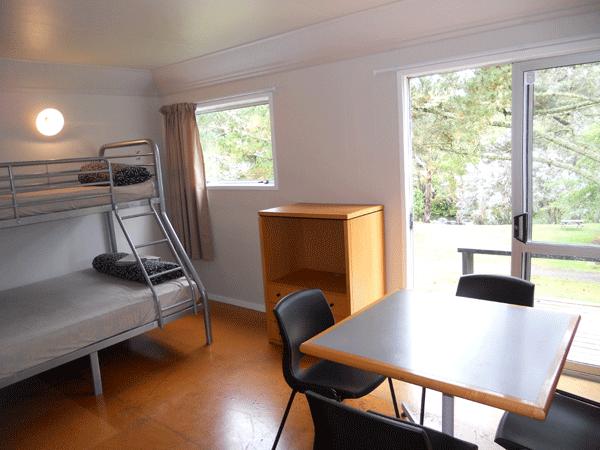Large cabin main room/table/door to verandah